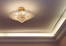 Crystal chandelier hanging on ceiling Royalty Free Stock Photos