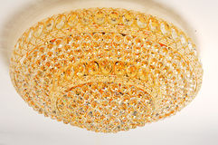 Crystal chandelier hanging on ceiling Royalty Free Stock Photo