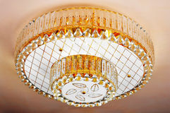 Crystal chandelier hanging on ceiling Royalty Free Stock Photography