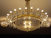 Crystal chandelier hanging from the ceiling inside of the independence palace Royalty Free Stock Photo