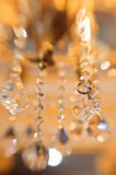 Crystal chandelier with hanging wedding ring Royalty Free Stock Photos