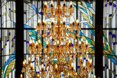 Crystal chandelier and leaded pane Stock Photo