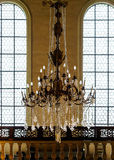 Crystal chandelier lighting in the big majestic hall Royalty Free Stock Photos
