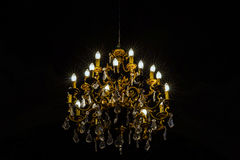 Crystal chandelier lighting in the big majestic hall Royalty Free Stock Photo