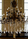 Crystal chandelier lighting in the big majestic hall Royalty Free Stock Images