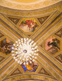 Crystal Chandelier and Painted Church Ceiling. Stock Photo
