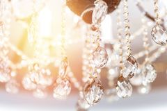 Crystal chandelier shimmers in light of close-up.  royalty free stock photos