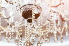 Crystal chandelier shimmers in light of close-up.  royalty free stock image