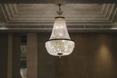 Crystal chandelier. Shines hanging from the ceiling in the hotel hall stock photos