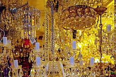 Crystal chandeliers. Lit in the shop window Stock Photo