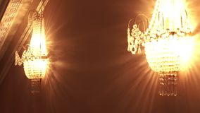 Crystal chandeliers sconces on wall. Chrustal chandelier stock video