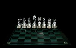 Crystal  chess board and figures Royalty Free Stock Photography
