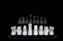 Crystal  chess board and figures Royalty Free Stock Photo
