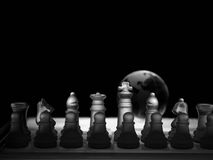 Crystal  chess board and figures. Crystal shess fugures on row against the world globe ,on black background Stock Photo