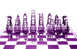 Crystal chessfigures. Glowing purple  Crystal chessfigures  on chessboard on  whute  background Stock Photography