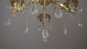 Crystal classic chandelier detail background. Crystals close up. Slowly stock video footage