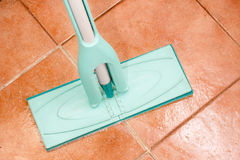 Crystal clean floor. Mop on the checkered ceramic floor Royalty Free Stock Photography