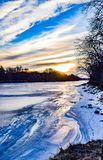 Vertical View of the Frozen Des Moines River. Crystal Clean Frozen Air over the Des Moines River in Iowa royalty free stock image