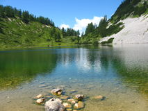 Crystal-clear alpine lake Royalty Free Stock Photo