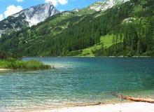 Crystal-clear alpine lake Royalty Free Stock Photos