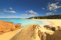 Crystal clear aqua waters of Jagger Beach Stock Images