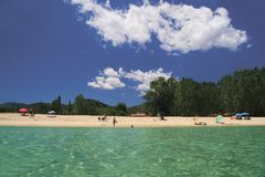 Crystal clear beach. Crystal clear sea with white clouds in a blue sky in Halkidiki, Greece Royalty Free Stock Image