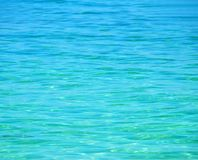 Crystal Clear Blue Sea. Sparkling clear turqoise blue calm sea suitable for background or texture Royalty Free Stock Photography