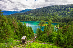 Crystal clear Caumasee lake near Flims, Grisons, Switzerland. Lift leading to crystal clear Caumasee lake near Flims, Grisons, Switzerland Stock Photography
