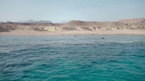 Crystal clear deep water of the red sea and the deserted shore of the island. Crystal clear deep water of the red sea and the deserted shore of the island stock video footage