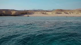 Crystal clear deep water of the red sea and the deserted shore of the island. Panorama. Slow motion.  stock footage