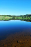Crystal Clear Dumont Lake with Glassy Surface Stock Image