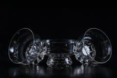 Crystal clear glass in dark on black Stock Photos