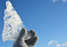Crystal clear ice piece at the hand Royalty Free Stock Image