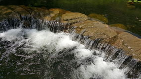 Crystal clear mini waterfall. Crystal clear water mini waterfall Stock Images