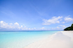 Crystal clear ocean and blue sky. A crystal clear ocean and blue sky with white sand beach in Thailand stock image
