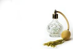 Crystal Clear Perfume Bottle avec la poignée d'or Photographie stock