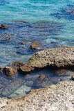 Crystal clear sea and rocks Stock Photo