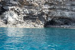 Ventotene sea. Crystal clear sea of ventotene, in the background the typical rock of volcanic origin - Pontine Islands stock image
