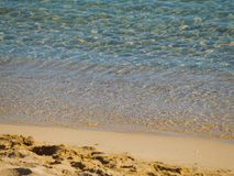 Crystal clear sea water and  empty sand beach stock images
