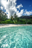 Crystal clear sea water and soft sandy beach Stock Images