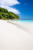 Crystal clear sea and white sand beach Stock Photo