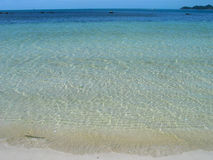 Crystal clear tropical blue beach... Evoking the most pleasant associations Stock Image