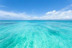 Crystal clear tropical sea of tropical Japan, Okinawa. Crystal clear tropical water of a coral reef lagoon, Yaeyama Islands, Okinawa, Japan Stock Photos