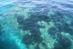 Crystal clear turquoise Mediterranean sea water stock photo