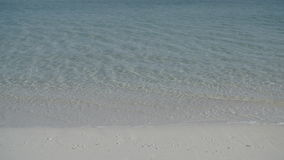 Crystal clear turquoise water on the beach stock footage