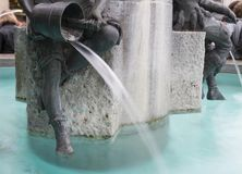 Fish Fountain in Marienplatz, Munich, Germany. Crystal clear turquoise water at The Fischbrunnen, the Fish Fountain in Marienplatz, Munich, Germany Royalty Free Stock Images