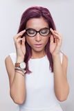 Crystal clear vision. Young woman having a moment of pleasure wearing eyeglasses Stock Images