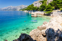 Crystal clear water of Adriatic sea in Brela on Makarska Riviera, Dalmatia, Croatia Royalty Free Stock Images