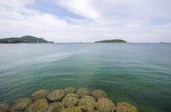 Crystal clear water with beautiful sky at Asadang BridgePier at Koh Sichang,Chonburi,Thailand Royalty Free Stock Photos
