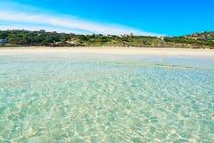 Crystal clear water in La Pelosa beach Stock Photos